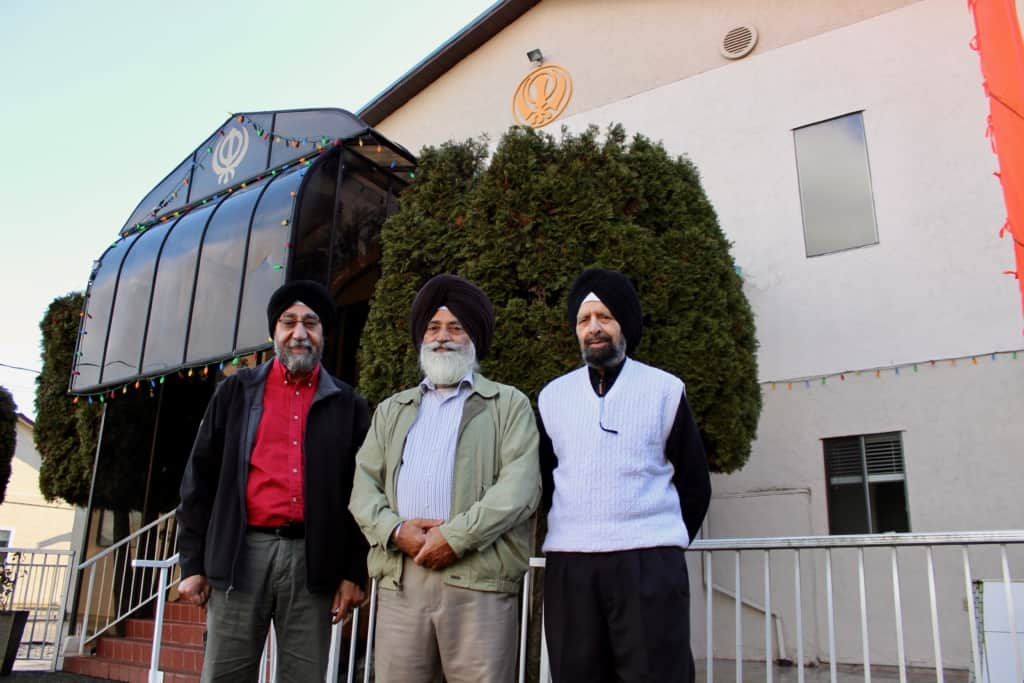 Community leaders Tek Manhas, Chanchal Singh Tiara and Surinder Singh Pagely stand outside the Duncan Sikh Temple.