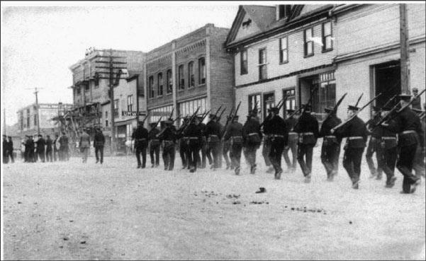 Coal strike Militiamen march down 1st Avenue in Ladysmith in August, 1913. Ladysmith & District Historical Society