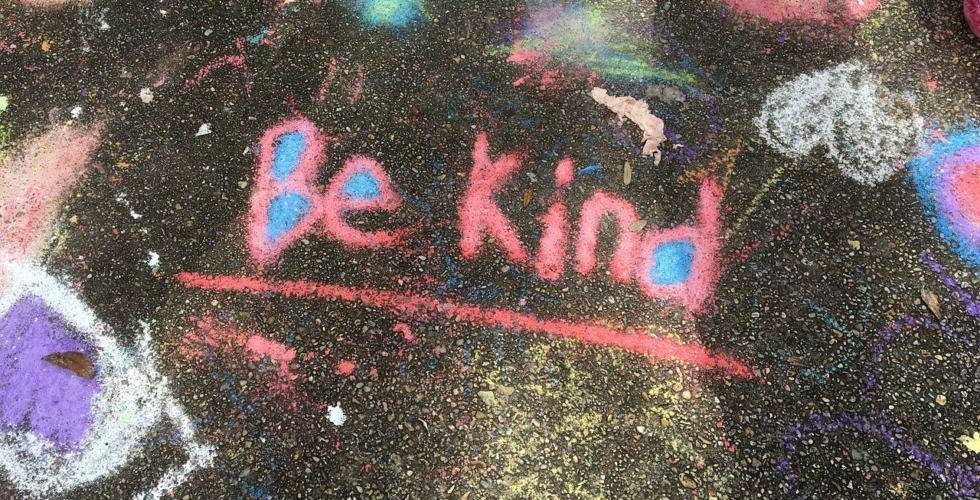 chalk drawing on pavement reads