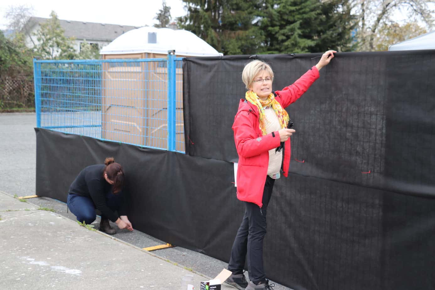 Debbie Berg CWAV installs privacy screens around the tenting site